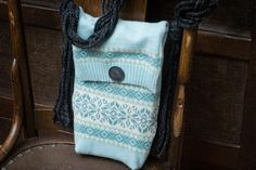 11 Ways to Upcycle Old Sweaters: To make this soft mini purse, Fiskars craft designer Kendra McCracken chose a thrift-store sweater with a generous rib that forms an interesting edge for the flap  far easier, she points out, than knitting a bag from scratch. The purse has a denim lining with a box bottom to create more room inside for must-have items, and the simple shoulder strap is made from braided yarn.  From DIYnetwork.com