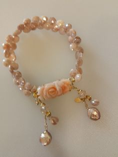 Hand carved coral clasp, moonstone briolette beads, freshwater pearls and Swarovski crystals
