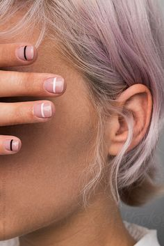 Unrecognizable girl hiding eyes with manicured hand in close-up