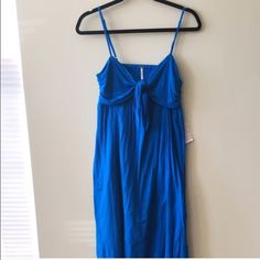 🚨 FINAL PRICE Free People Blue Maxi Dress NWT Free People Blue maxi dress. Playful knotted front with back-bearing cutout. V-neck, adjustable straps. Hi-low hem. No modeling or trades! Free People Dresses Maxi