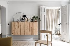 Wood cabinet in an inviting apartment with warm tones in Södermalm, Stockholm /Husman & Hagberg.
