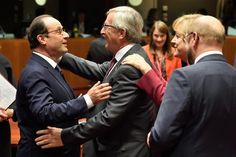 Embrace between François Hollande, President of the French Republic, and Jean-Claude Juncker, President of the European Commission as from 01/11/2014 in the presence of Angela Merkel, German Federal Chancellor, and Martin Schulz, President of the European Parliament (in the foreground, from left to right). European Council of Brussels, 23-24/10/2014. Discussions focused on getting the right balance in the EU's approach on the Economy so it could stimulate growth and reduce unemployment. (EC…