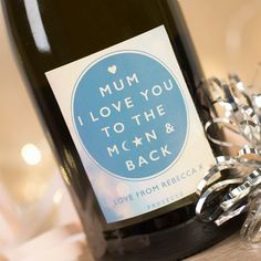 A bottle of bubbly with your words printed on the bottom of the label! | Personalised Prosecco - The Moon & Back | GettingPersonal.co.uk
