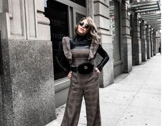 Click here to learn how to style a plaid jumpsuit on Life Lutzurious. You will love how stylish and warm this plaid jumpsuit outfit is for the winter! Get style inspiration from this black jumpsuit you can wear all winter long. This plaid jumpsuit outfit is the type of street styles I adore wearing during the colder months of the year. Be sure to try out this casual jumpsuit if you're trying to switch around your wardrobe! #plaid #plaidjumpsuit #jumpsuit