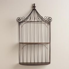 One of my favorite discoveries at WorldMarket.com: Brown Wrought Iron Shelf Birdcage