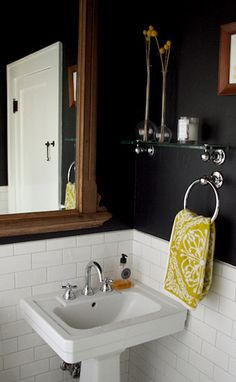 love the black walls with the white tile and warm wood mirror