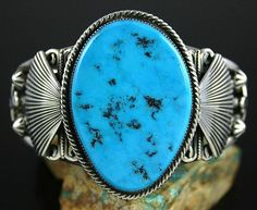Gary Reeves RARE Gem Grade Blue Gem Turquoise Bracelet | eBay Navajo jeweler Gary Reeves has selected a rare gem grade natural Blue Gem turquoise to set In heavy sterling silver. The gem is from a mine that was depleted in the early 1970s. It is an electric sky blue with black chert matrix flecks. Gary created the piece in the late 1980s and was collected because of the unusual size and rarity of the gem.  $795