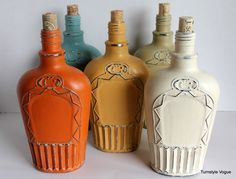 painted royal crown bottles  might have to start drinking some Crown Royal so I can get empty bottles