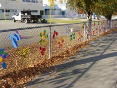 Garden City students team up with other community members, creating fence art in an effort to bring beauty to the school.
