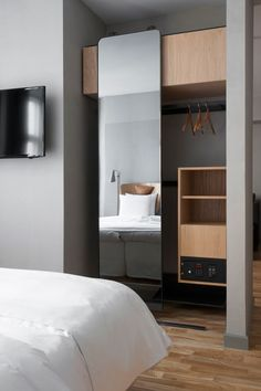 The Hotel SP34 becomes a design destination in Copenhagen's old Latin Quarter with simple, understated elegance. Boutique Hotel Bedroom, Hotel Bedroom Design, Small Boutique Hotels, Design Hotel, House Design, Open Wardrobe, Sliding Wardrobe, Mirrored Wardrobe, Wardrobe With Mirror