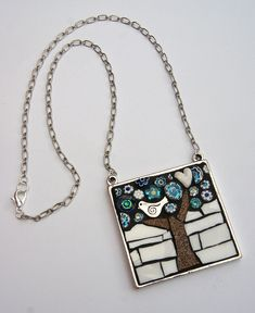 Bird in a tree - blue and white by Angela Ibbs Mosaics at BreezyB5, via Flickr