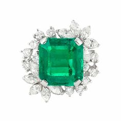 Platinum, Emerald and Diamond Ring  Centering one cut-cornered emerald-cut emerald approximately 5.00 cts., surrounded by 24 round and marquise-shaped diamonds approximately 1.50 cts.