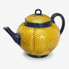 English majolica basket-weave teapot   second half 19th century   Ovoid form, the domed cover molded with wicker pattern glazed in yellow and surmounted by loop handle in cobalt blue, the body similarly decorated.
