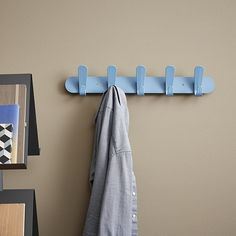 The Krok series of coat hooks excels in simplicity. The three wall mounted coat racks Krok HJH 30, 60 and 90 have two, five or eight high-quality plastic double hooks. The rigid steel wall plate can be mounted to a timber, brick or concrete wall with the two screws supplied, which are the same colour as the wall plate. Available in seven colours. http://www.van-esch.com/en/products/coat-stand/wall-coat-rack/krok-hjh-30-60-90