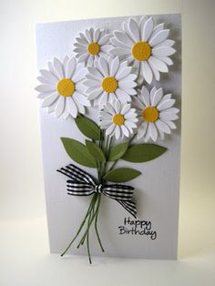 handmade birthday card ... boquet of bright die cut daisies ... luv the gingham bow holding the stems together ...