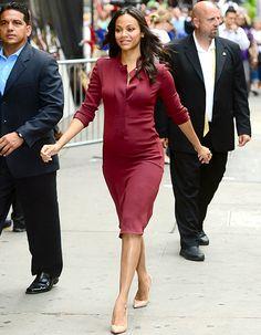 Zoe Saldana wears a burgundy Calvin Klein dress in NYC