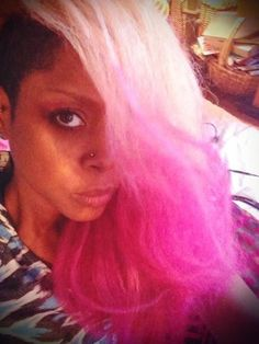 Erykah Badu can get away with any color of 'do