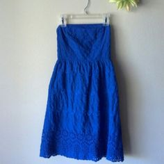 """**Host Pick**Old Navy Strapless Dress Old Navy strapless, blue eyelet dress. Elastic to stretch on the back. Liner attached. Has no-slip strip inside at chest area. Zipper on the side & small hook closure. Has been worn & washed. Length approx 28"""" from top front to bottom; just below bust area approx 12"""" across. Beautiful condition!! Sorry, no modeling. Price FIRM unless bundled. Old Navy Dresses Strapless"""