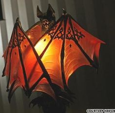 spooky orange glass bat lamp