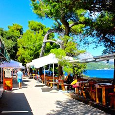 Korčula Croatia - The fortress ramparts have been turned into a walkway of restaurants to enjoy the island breezes