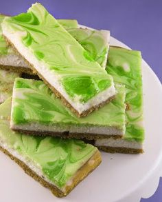 Key Lime Swirl Cheesecake Bars - I love cheesecake and think it should be a food group. And I love limes. Think I'll try this for St. Patrick's Day. The top is so pretty to look at - probably even better to eat!