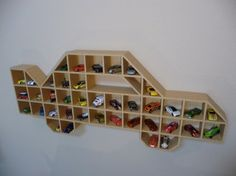 I think Papa is going to build this for Cannon's race car toy room we're in the process of doing! It'll be great for holding his endless Matchbox and Power Wheel cars supply!! ;)
