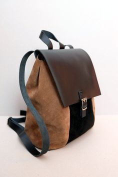 Rucksack made of high quality genuine leather and shammy leather.    Closes on the button hidden under buckles    It has got regulated straps.    Size: