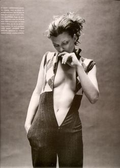 Mixte (France) Fall 1996/Winter 1997, Milla Jovovich in a pinstripe/argyle zippered jumpsuit by Valentino.