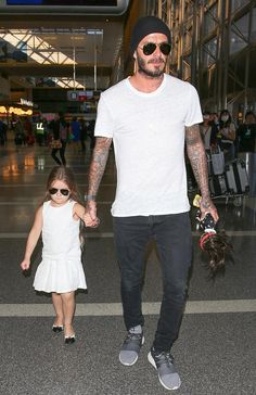 Daddy's girl: David Beckham ferried the couple's youngest child Harper - and only daughter - through the busy terminal and carried her doll too Casual Outfits, Men Casual, Fashion Outfits, David Beckham Style, David Beckham Kids, The Beckham Family, Harper Beckham, Victoria And David, Daddys Girl
