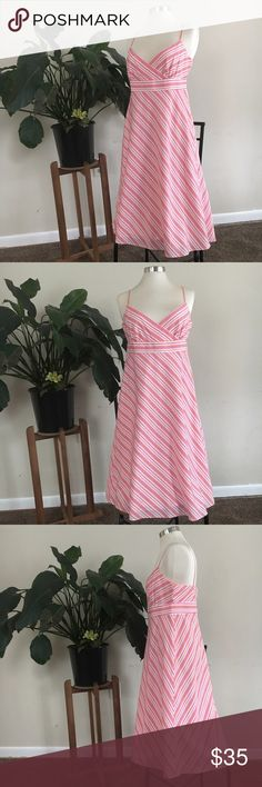 """J.Crew stripped dress Orange and pink spaghetti strap dress. 100% cotton, with zipper on the back. In great used condition! measurements: 42"""" from shoulder strap to hem, 15 1/2 """" under bust and 21 """" around hips. J. Crew Dresses"""