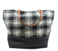 So Pacific Northwest - love the mix of leather and cozy textile on this bag. $64, www.mooreaseal.com.