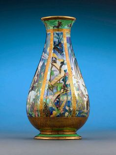 One of the earliest Fairyland Lustre motifs, this Pillar pattern vase by Wedgwood features the fantastical Isle of the Genii, populated with nymphs and elves at every turn. Introduced by Wedgwood artist Daisy Makeig-Jones in Fairyland Lustre Porcelain Figurines, Vases And Vessels, Art Decor, Nymph, Art, Pottery Art, Fairy Land, Glass Art, Beautiful Art