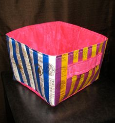 Ribbon Quilt Fabric Basket made from AKC dog show ribbons. Lined, cotton handles, folds flat for storage. Great for storing your dog obedience, agility, or training tools! Handmade fabric storage bin.