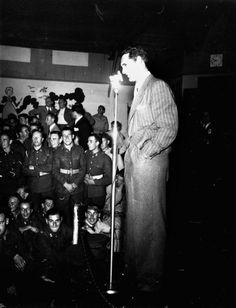 Cary Grant entertains servicemen at The Hollywood Canteen, c. 1942.