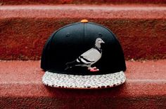 "Part of the 1st delivery from Staple Design's Spring/Summer 2012 Collection, ""Staple Theology"" is a clever STAPLE PIGEON SAFARI snapback.  It sports a safari patterned bill, iconic Pigeon up front, and a bird turd on the back!  Nice!"