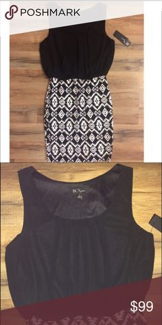 NWT black and white dress NWT! So cute! Printed stretchy bottom with black blouse top. No trades. BCX Dresses