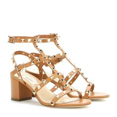 Valentino - Rockstud leather sandals - A pair of light brown sandals will fit perfectly into your summer shoe edit. These block-heel leather sandals feature plenty of straps that are topped off with those classic pyramid studs. A more feminine take on the military trend, this pair works especially well with khaki hues. seen @ www.mytheresa.com