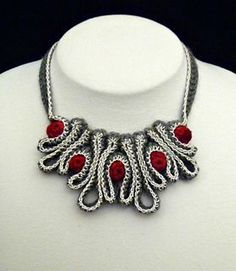 Beautiful crochet necklace.  Hard to look away.  Can also be knitted.   http://www.ravelry.com