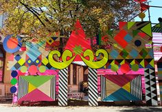 With neon colours and bold patterns, Morag Myerscough and Luke Morgan pay homage to cultural diversity with a pavilion developed to reflect the wide range of cultures, ethnicities and races in an area of Graz, Austria.