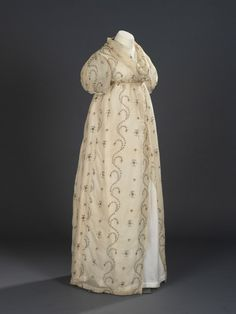 Beautiful wrap dress, ca. 1795. Click on the link to get a closer look at the wonderful embroidery.
