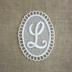 Vintage Embroidered Letter L by LisbonStory on Etsy - shadow box framed in the nursery