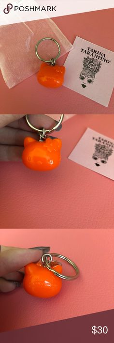 "Tarina Tarantino Orange Hello Kitty Head Keyring 🎀Pretty keyring of Hello Kitty by Tarina Tarantino 🎀Never used! 🎀I believe this was a gift with a purchase from TT over a certain amount, was never for sale itself  🎀Has a regular split keyring and silver hardware 🎀Measures 2"" tall total and 1"" across  ‼️Price is negotiable but please consider the 20% posh fees. NO trades‼️ Tarina Tarantino Accessories Key & Card Holders"