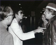Raymond Chow, Bruce Lee, Sterling Silliphant and his wife at Kai Tak airport