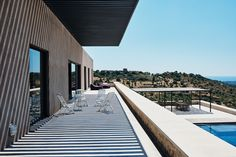 Chiaroscuro effects, stunning cobalt pool and breath-taking views over the sea and countryside at Casa Vera.