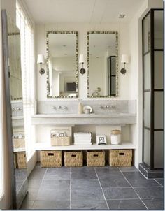 love the mix here, the mirrors, the sink, the shower.  jill sharp brinson