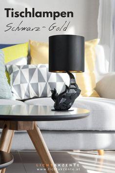 """Die Design Tischlampe """"Nashorn"""" mit runden Lampenschirm in Schwarz und Gold findest du bei Lichtakzente.at. Die schwarze Tischlechte trägt zur gemütlichen Beleuchtung im Wohnzimmer, Schlafzimmer, Esszimmer, Flur oder in einem Hotelzimmer bei. Lampe Tisch, Tischlampe modern Design // #leuchte #wohnen #beleuchtung #licht #interiordesign #lampen und leuchten #lichtakzente Interiordesign, Table, Gold, Furniture, Home Decor, Lighting Ideas Bedroom, Headboard Lamp, Bed Lights, Decoration Home"""