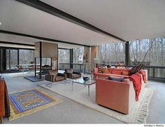 The Highland Park, Illinois home was designed by architects A. James Speyer and David Haid and built in 1953. It features four bedrooms and a living room that cantilevers over a ravine.