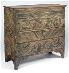 Early New England Painted and Decorated Pine Two-Drawer Lift-Top Blanket Chest, C.1800, with bold stylized graining in black on a faded salm...