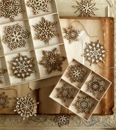 Snowflake Ornaments. Create a wooden wonderland of delicate birch veneer snowflakes. Each piece is skillfully laser cut, leaving a burnt edge that helps to define the detailed shape. Each set arrives in wooden gift box. Natural Christmas. Country Christmas. Rustic Christmas. Simple Christmas. Mountain Christmas.