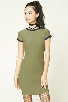A soft knit ringer T-shirt dress featuring a round neckline, short sleeves, and a rounded hem.